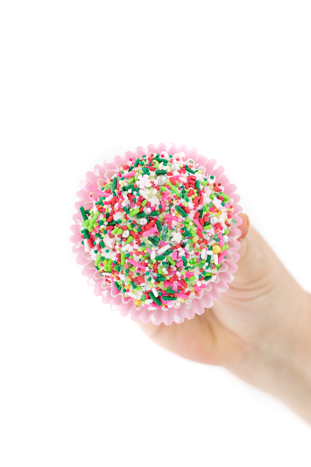 dipping frosted cupcakes into sprinkles to get them to stick