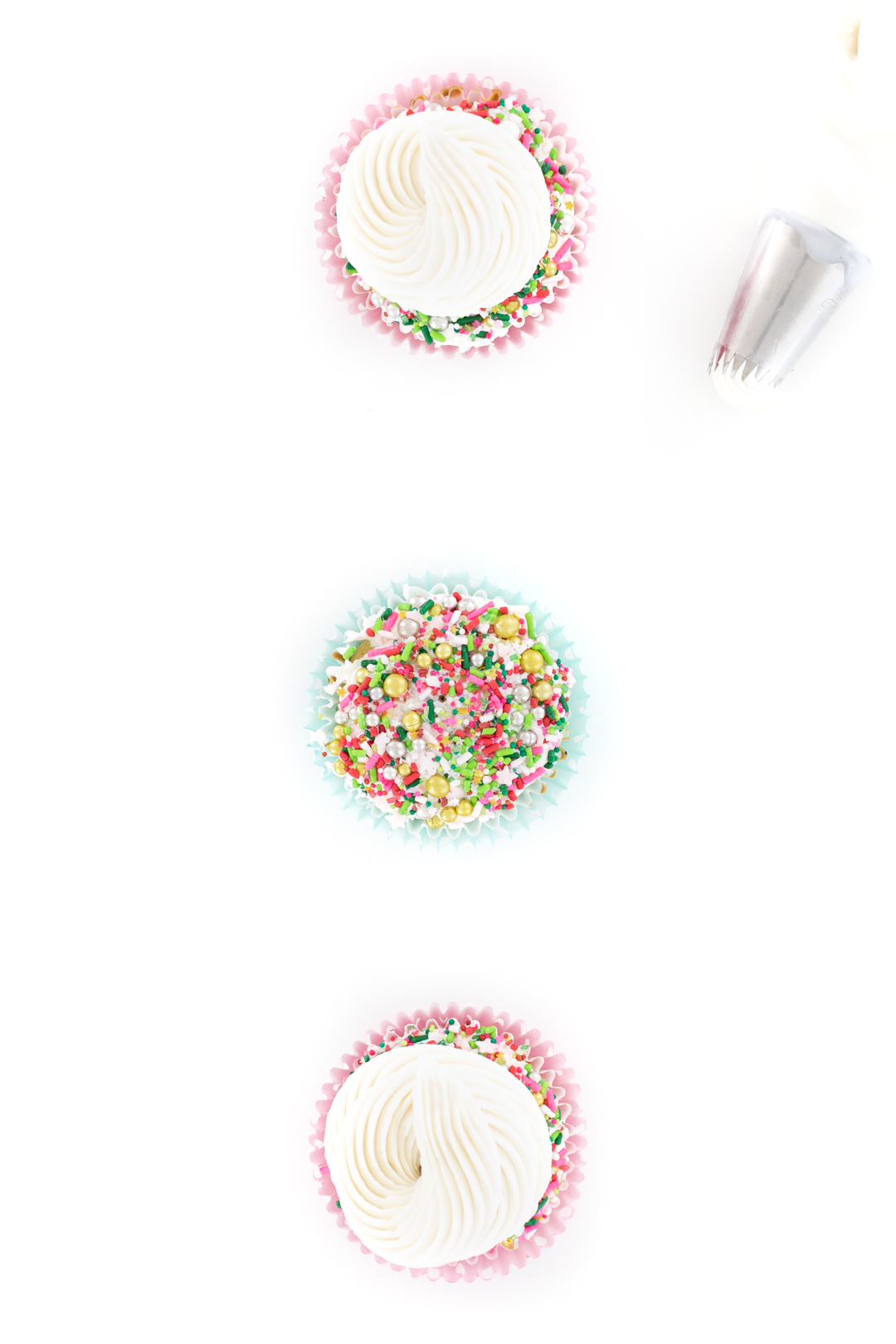 demonstration of how to put sprinkles on cupcakes