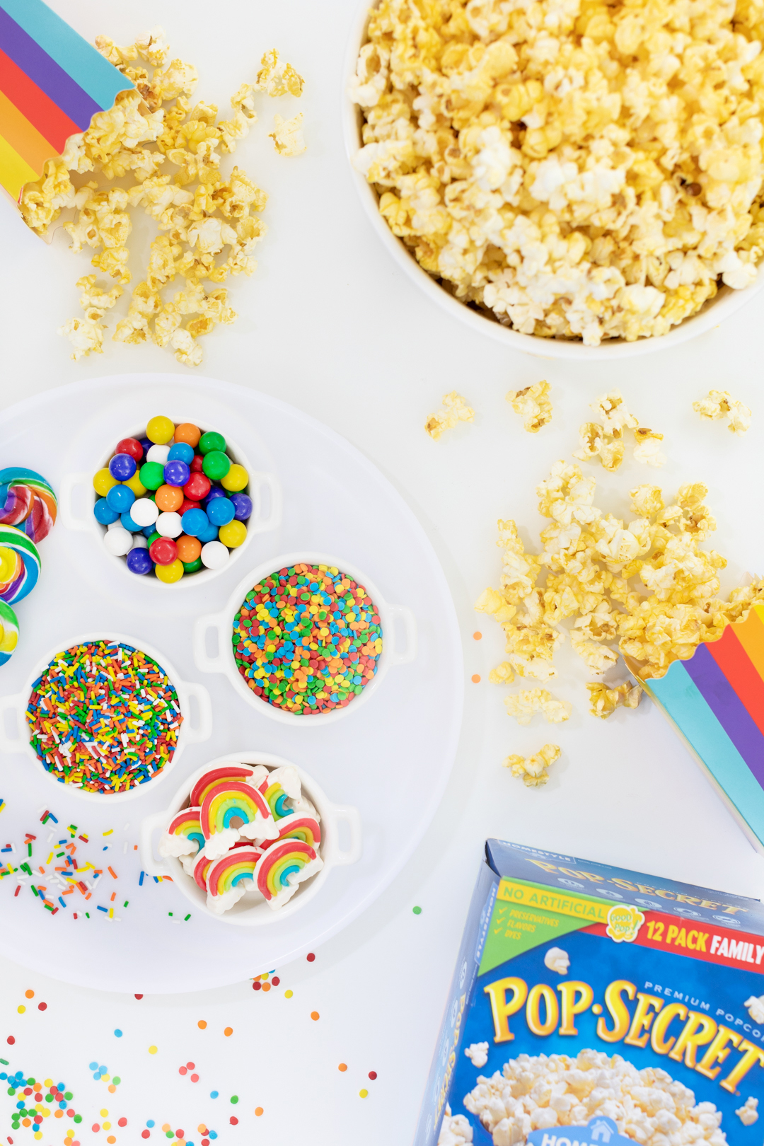 fun rainbow popcorn charcuterie board
