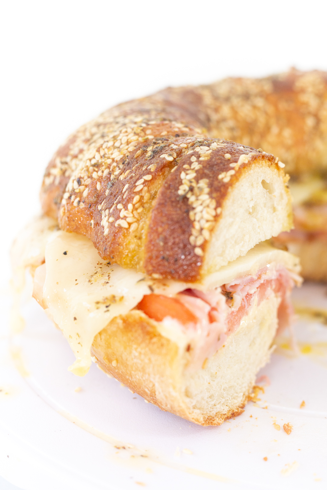 giant sandwich with sesame seed loaf filled with melty cheese.