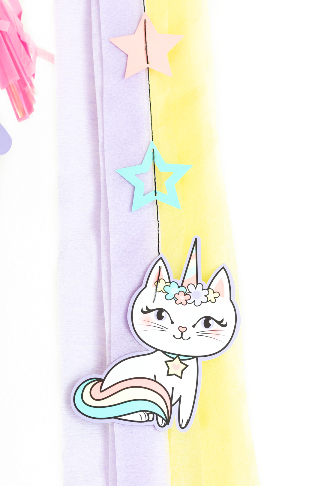 caticorn hanging decoration against yellow and purple streamers