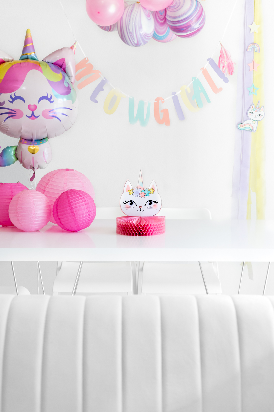 caticorn party table with balloons, tablescape and caticorn meow-gical banner