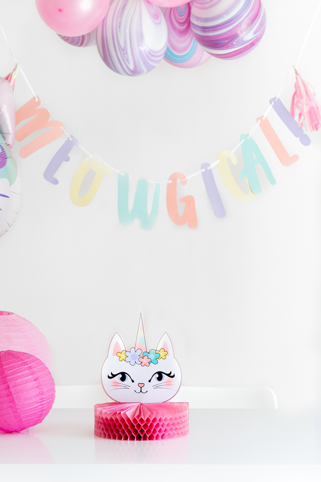 meowgical banner for a caticorn party. marbled pastel balloons.