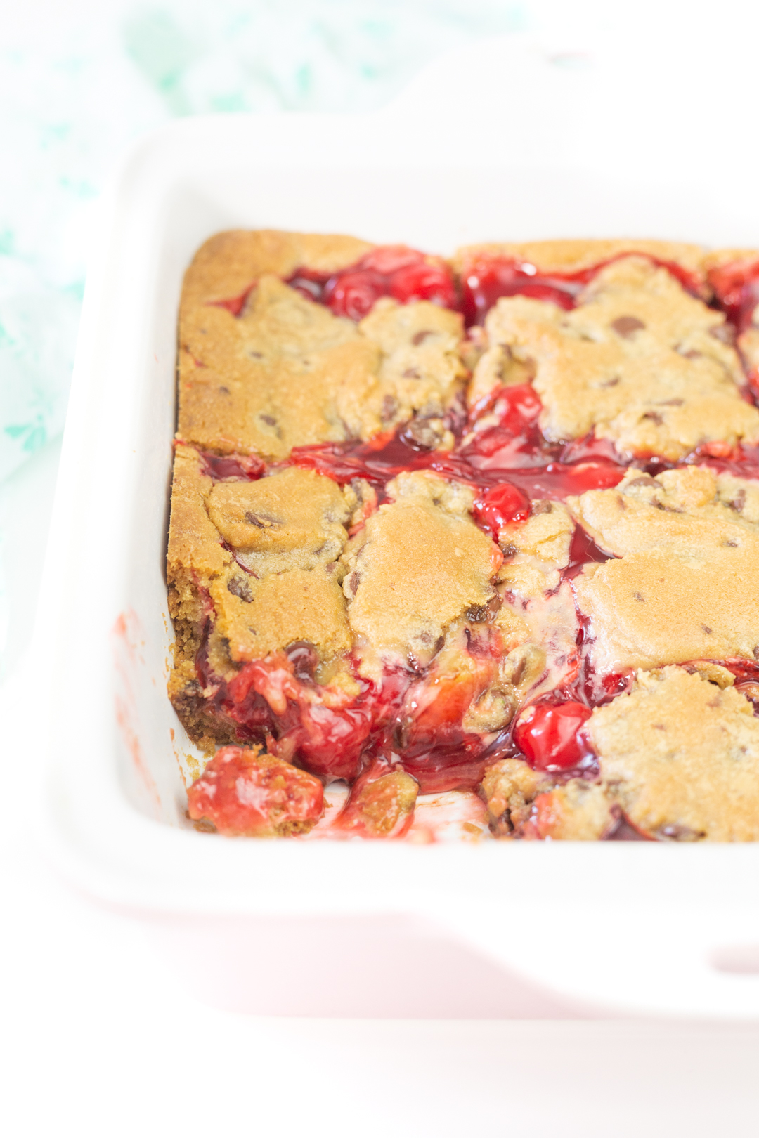 chocolate chip cherry bars up close with oozy cherry filling