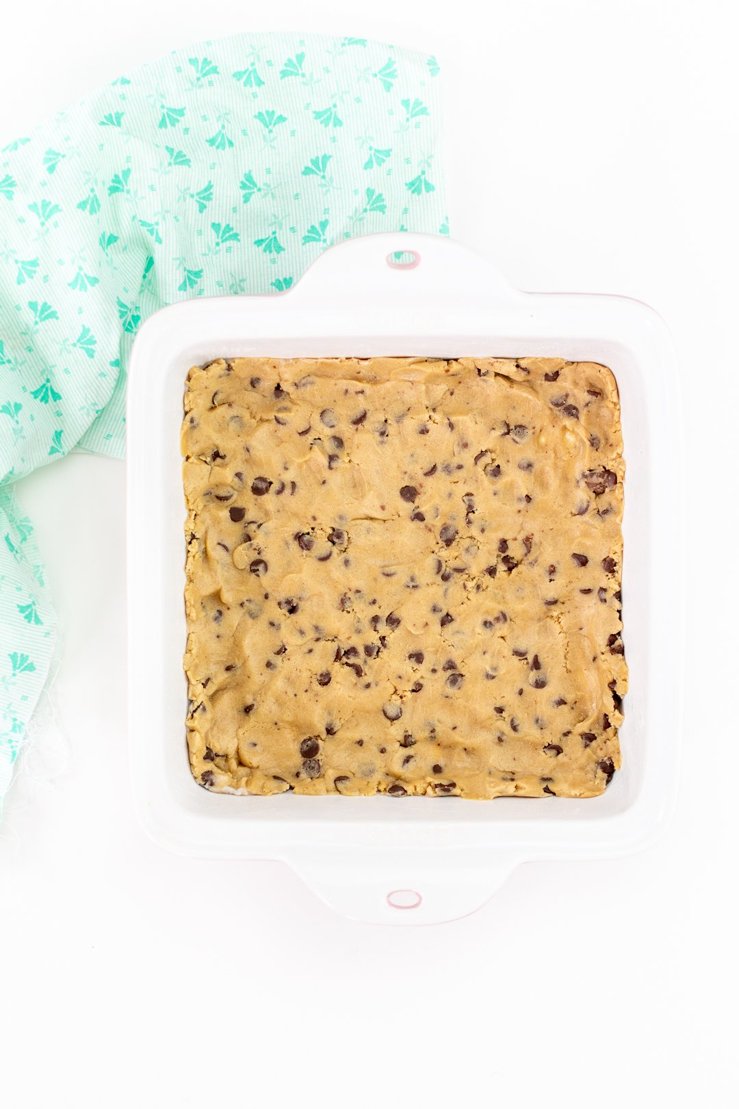 chocolate chip cookie dough pressed into baking dish