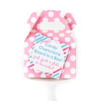 close up of small pink polka dot favor box with gift tag on it
