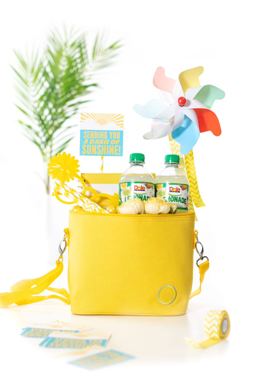 sunshine gift basket mini cooler with cold drinks and other yellow trinkets. Sunshine Gift Tag.