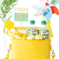 diy gift basket that is yellow themed. All gift trinkets are placed into a yellow mini cooler to deliver