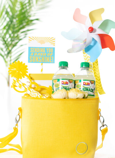 """diy gift basket that is yellow themed. All gift trinkets are placed into a yellow mini cooler to deliver """"sunshine"""" to a friend"""
