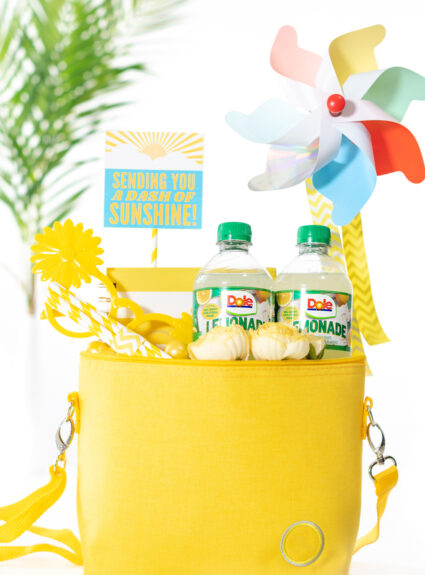 "diy gift basket that is yellow themed. All gift trinkets are placed into a yellow mini cooler to deliver ""sunshine"" to a friend"