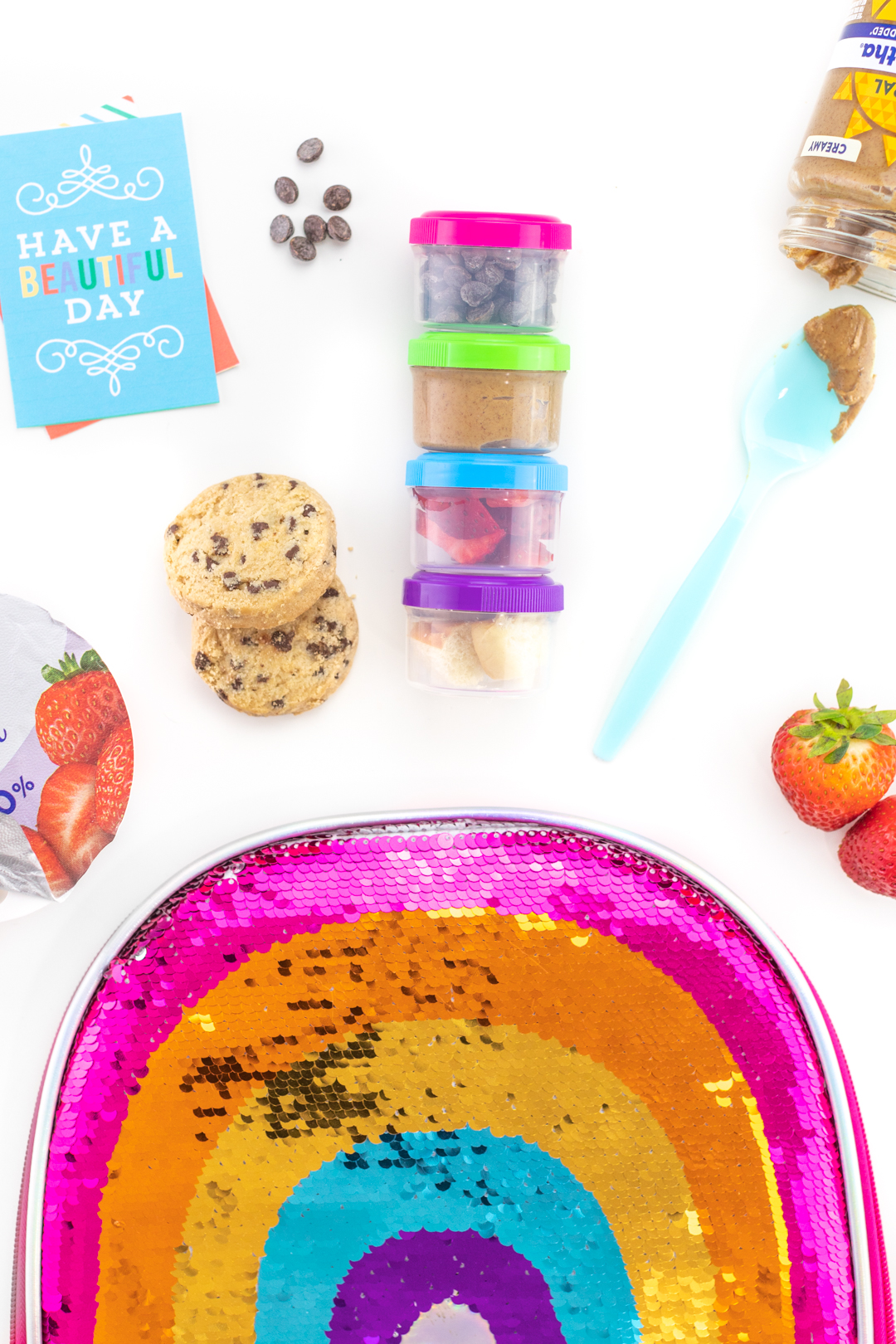 kids lunch with yogurt toppings in little containers so they can diy their lunch