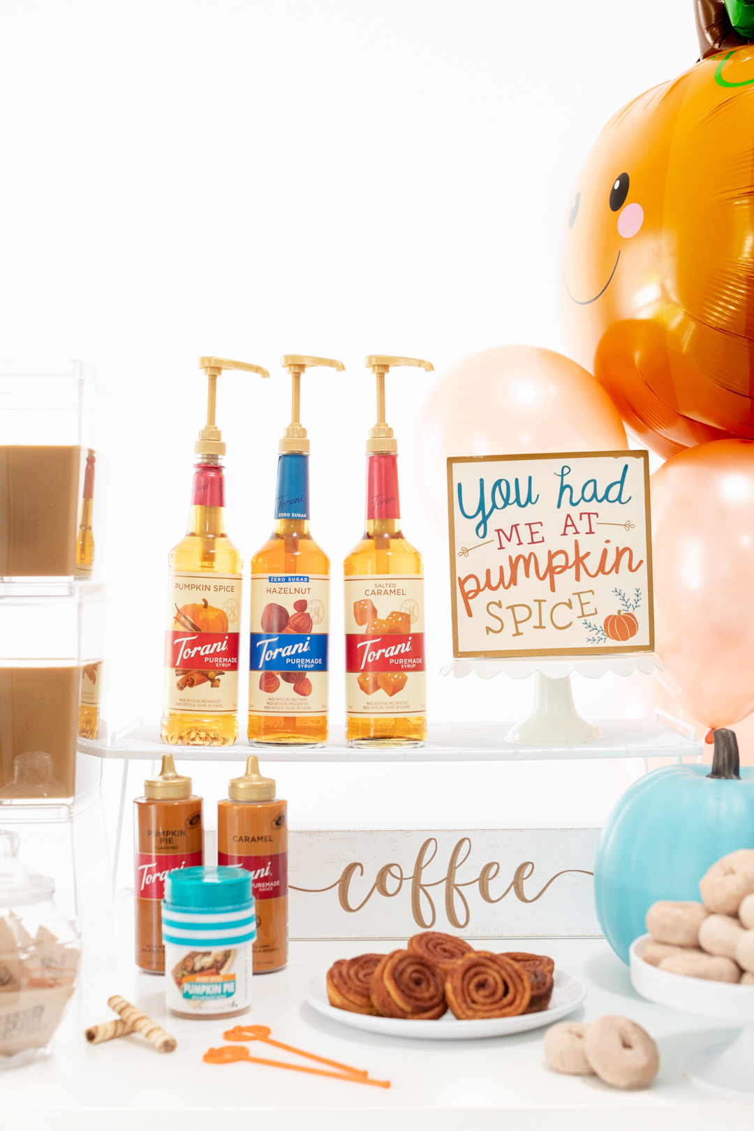Easy coffee bar for fall featuring iced coffee, mini donuts, pecan swirls and more treats