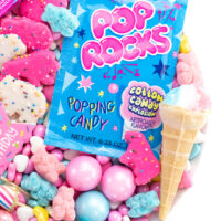 candy platter with pop rocks and gumballs and other small candies and cookies