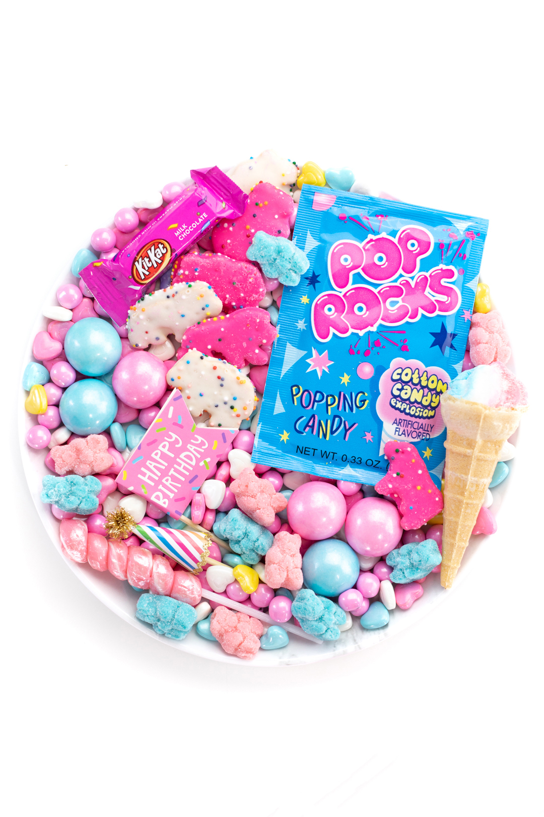 cute blue and pink candy board for one with ice cream cone candy, gumballs, lollipops and circus cookies