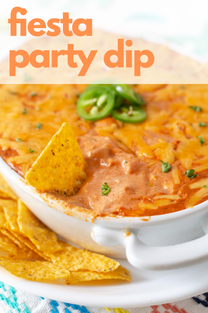 Rich tomato-based creamy Mexican dip recipe topped with melty cheese.