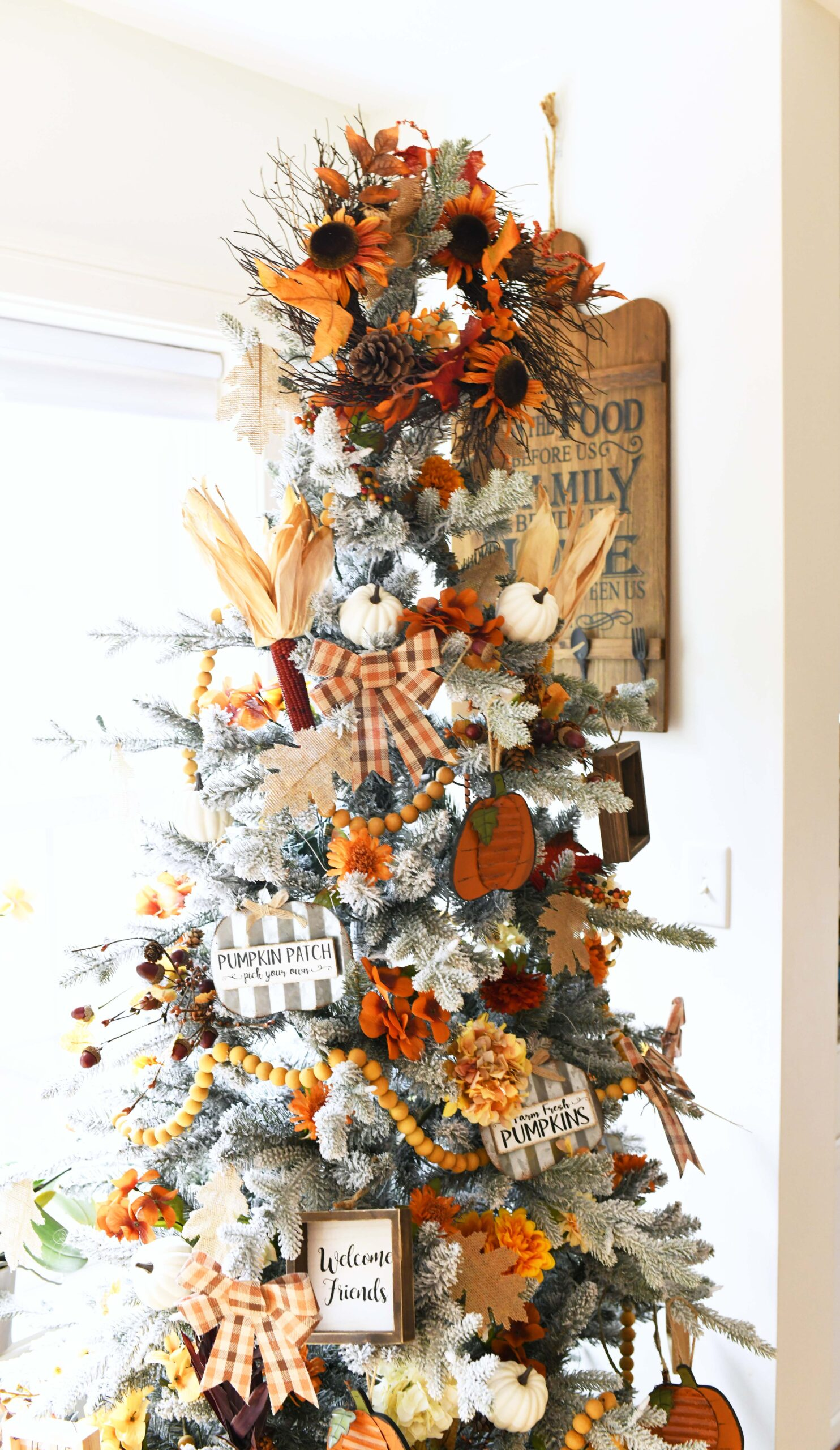 fall inspired christmas tree with earthy fall tones