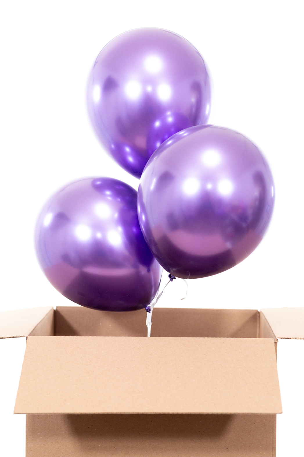 putting balloons into cardboard box to gift to friends