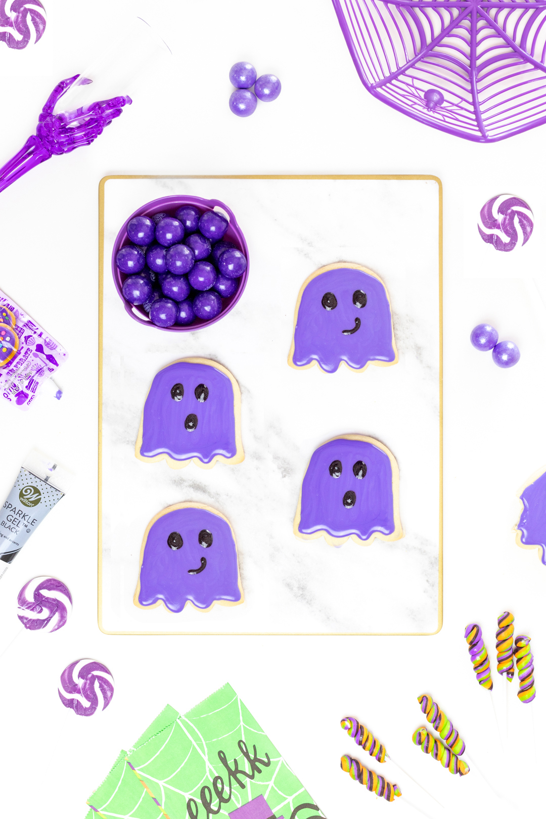 purple ghost cookies on a marble serving tray