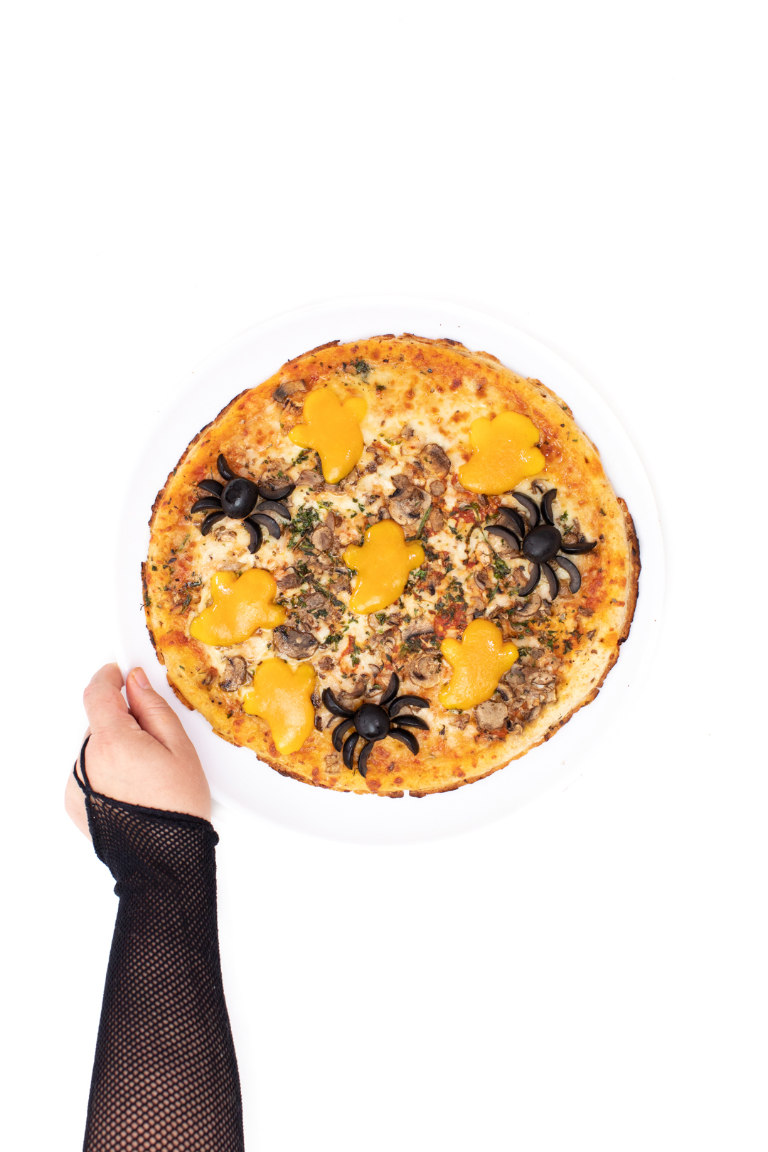 spider pizza with cheese ghosts to celebrate halloween
