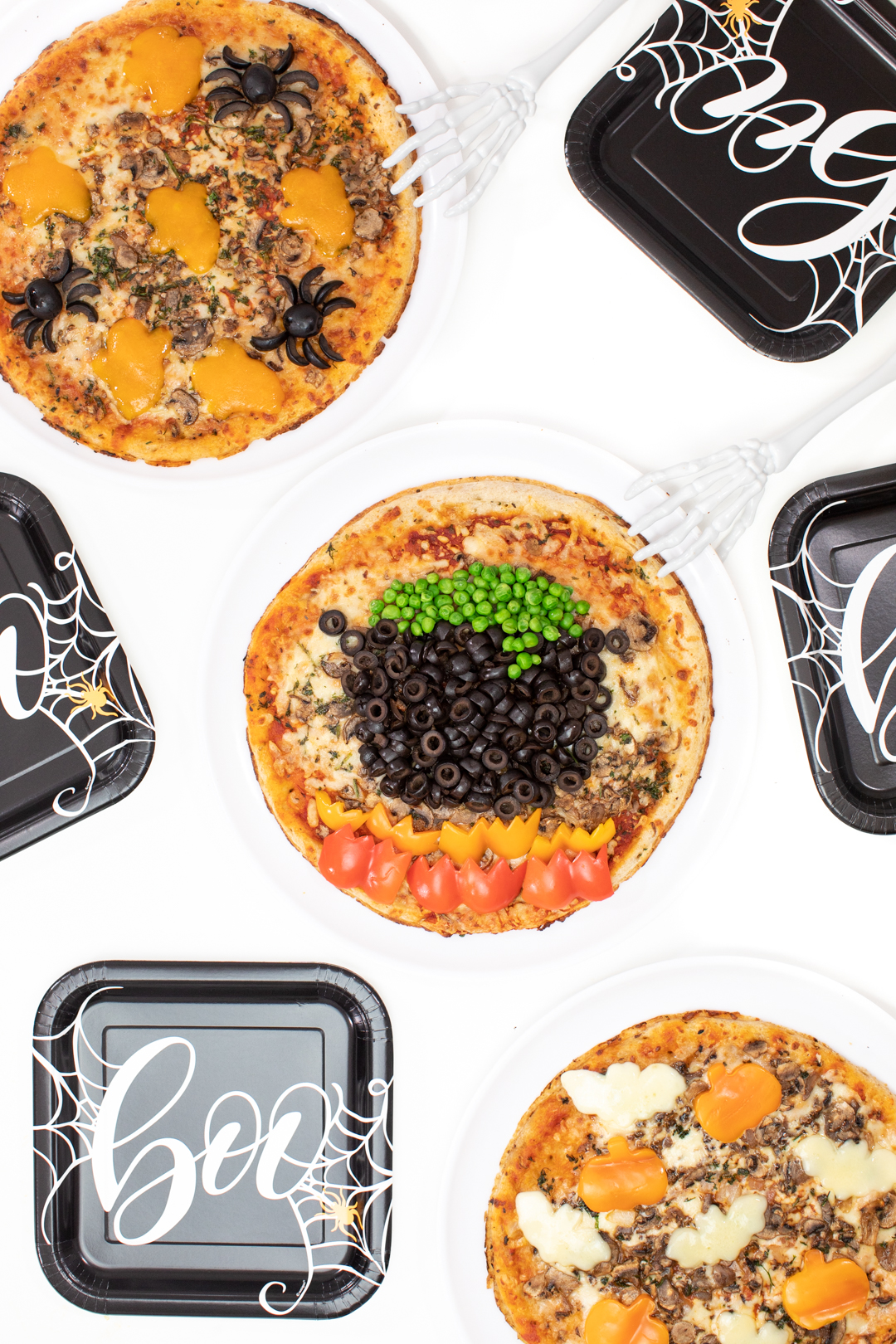 pizza party ideas to celebrate halloween. Festive witch inspired pizza and halloween paper serve-wear.