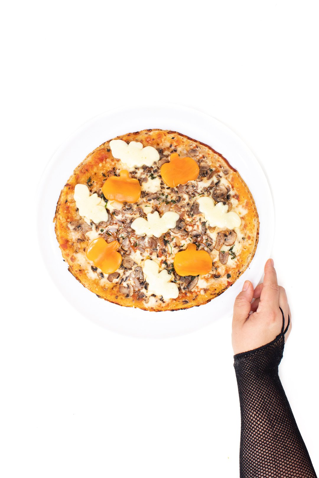 halloween pizza with pepper bags and cheese bats