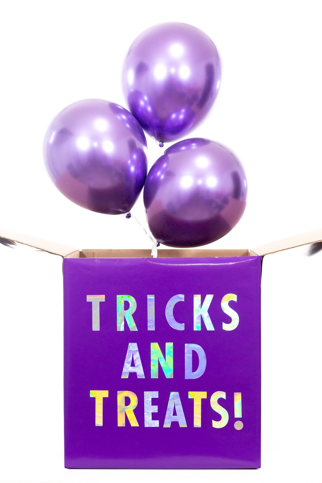purple halloween diy gift box with metallic purple balloons coming out of it.