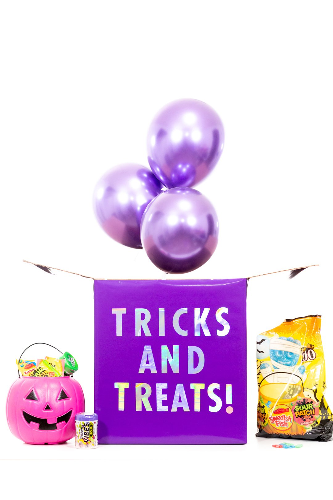 Tricks AND Treats Box that you can make to surprise friends. Fill it with candy and other Halloween toys and goodies.