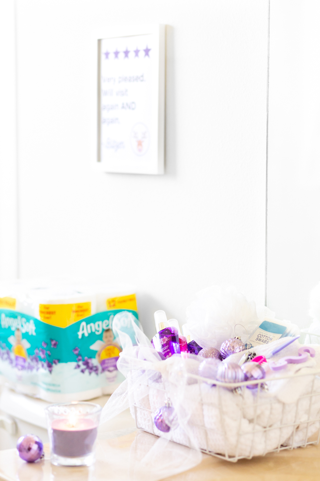 pretty holiday guest bathroom refresh with printable sign, candles and toiletries basket