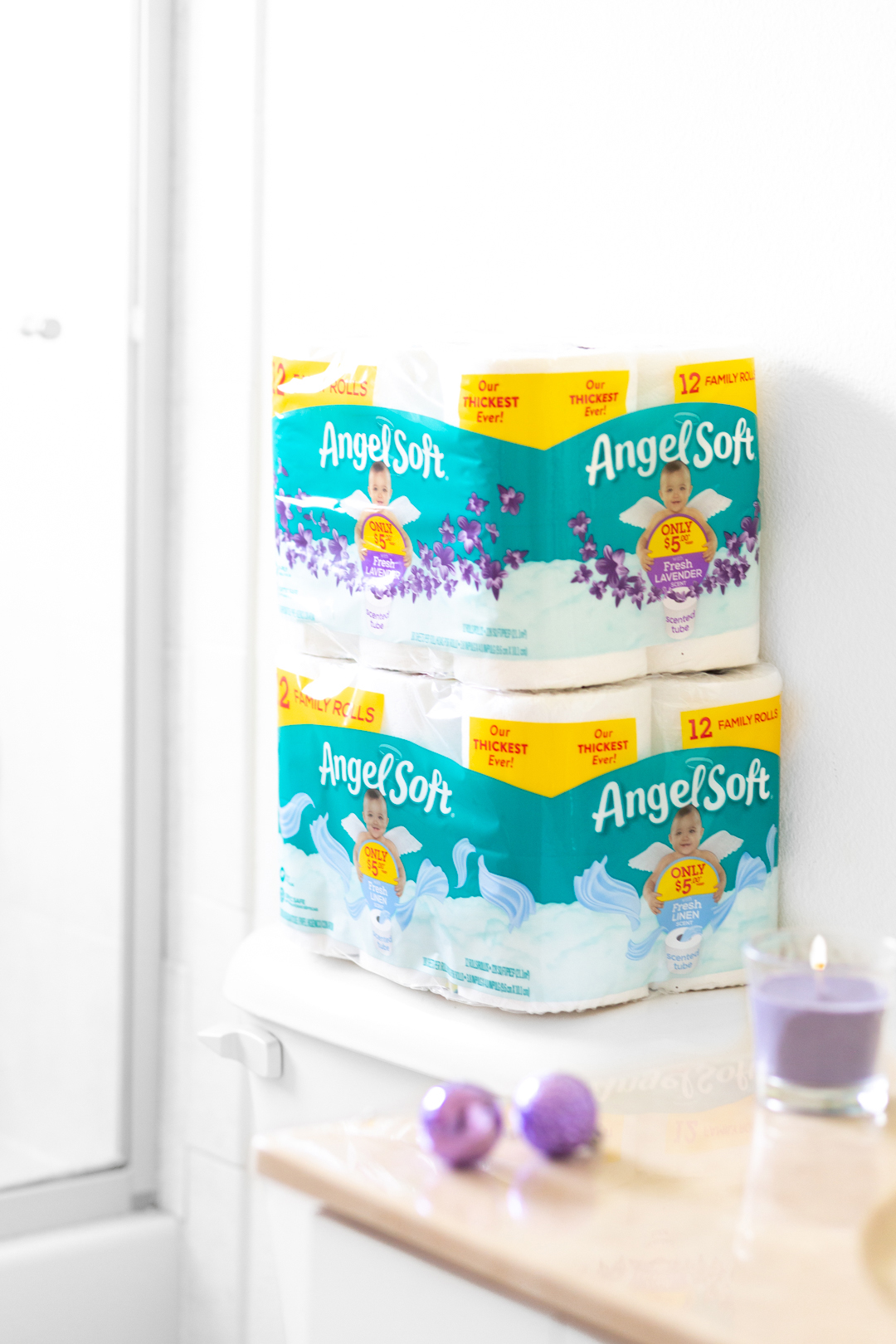 Angel Soft Scented Toilet Paper in soft bathroom setting with purple accents to make the lavender pop