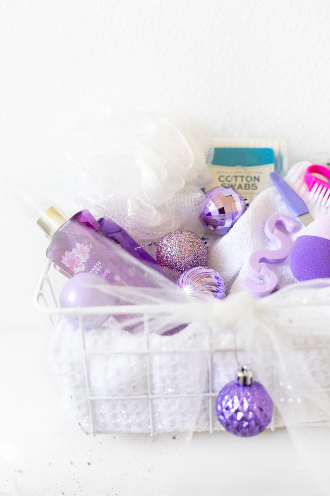 purple holiday themed toiletries basket for guest room