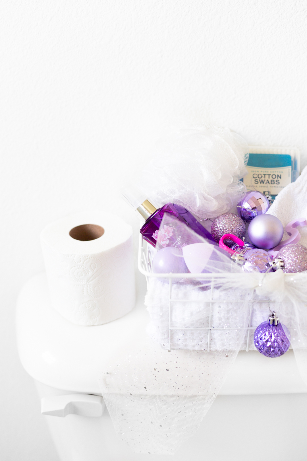 up close of purple christmas themed toiletries basket in a guest bathroom