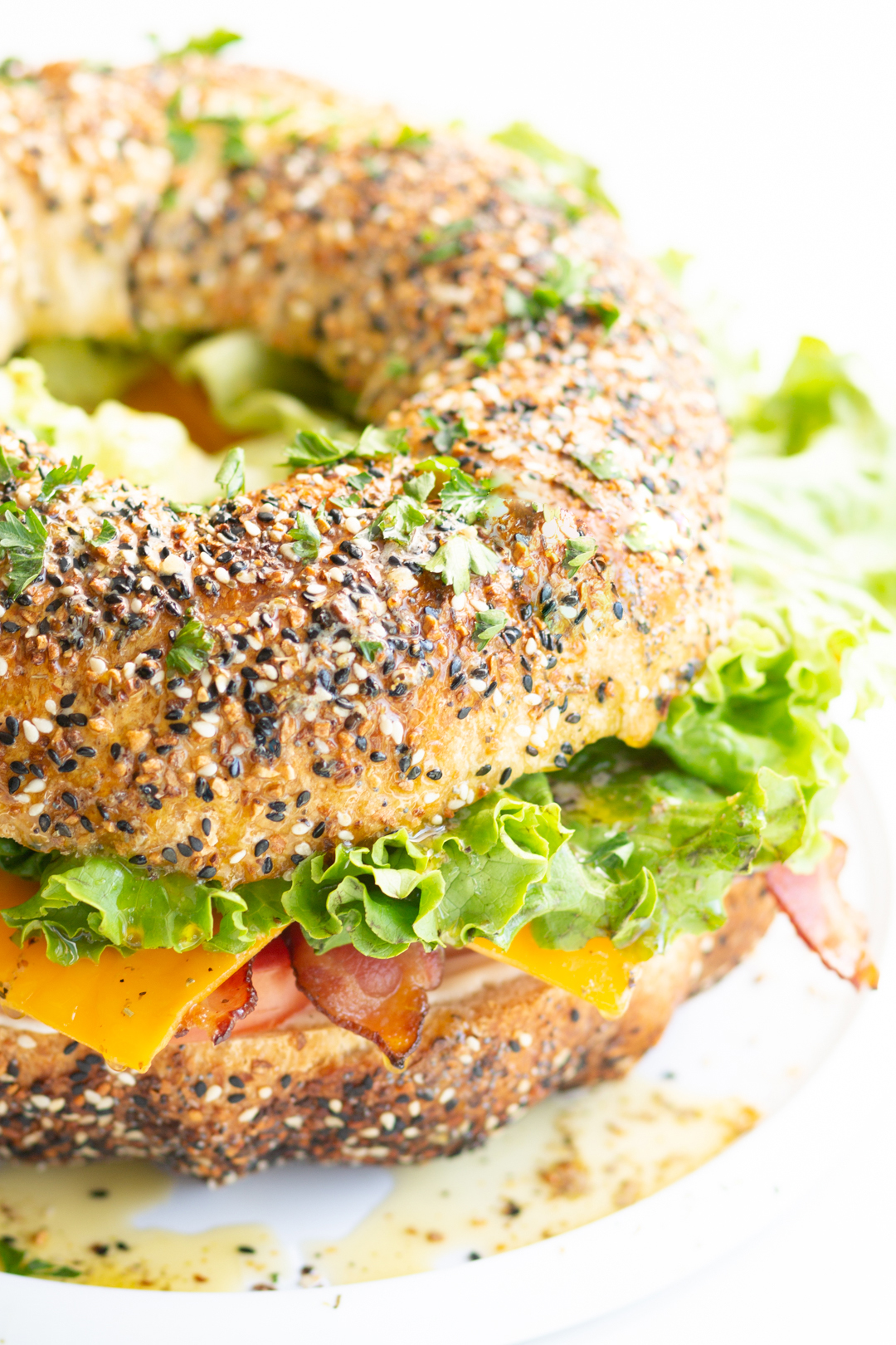 BLT bundt sandwich stuffed with BLT toppings and topped with fresh herbs
