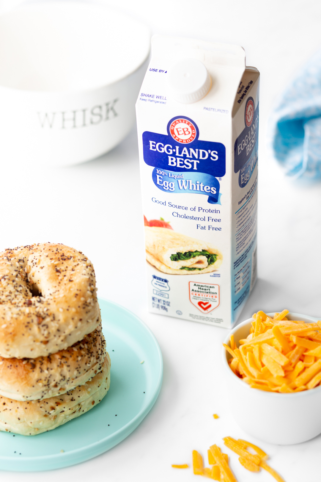 ingredients to make breakfast set out along with everything bagels
