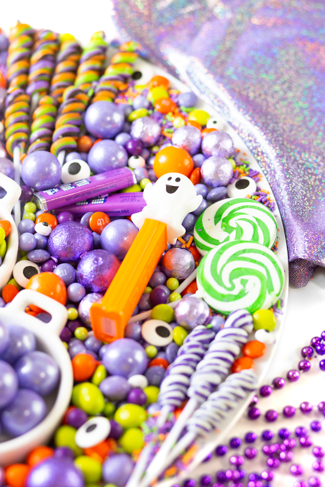 Ghost Pez dispenser, green swirl lollipops, purple swirl lollipops, eye candy