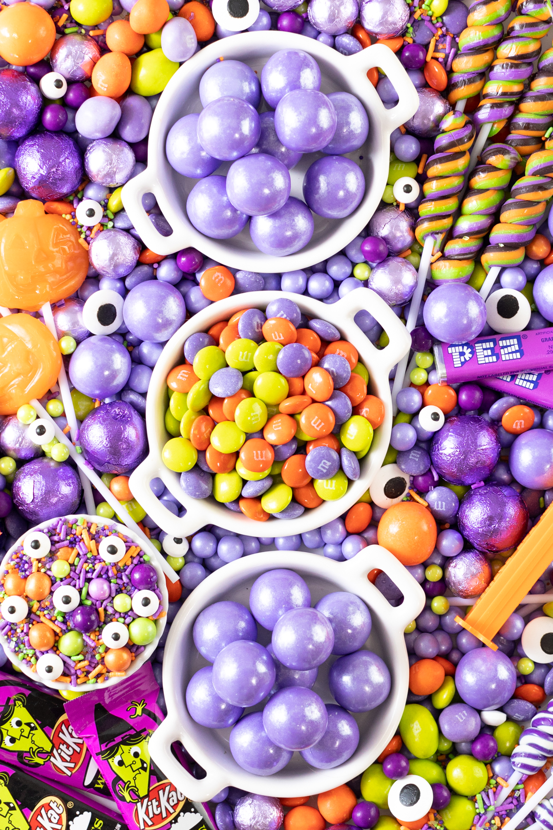 purple, orange and green halloween candy table