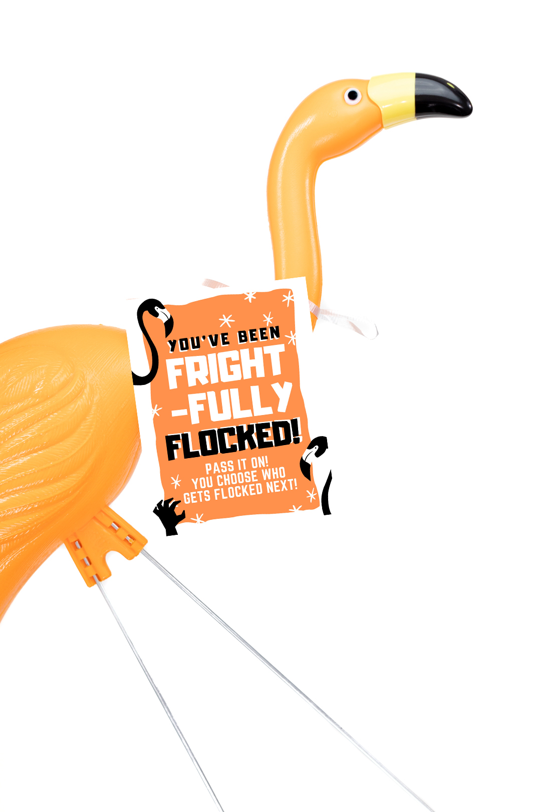 orange halloween flamingo with a you've been flocked sign