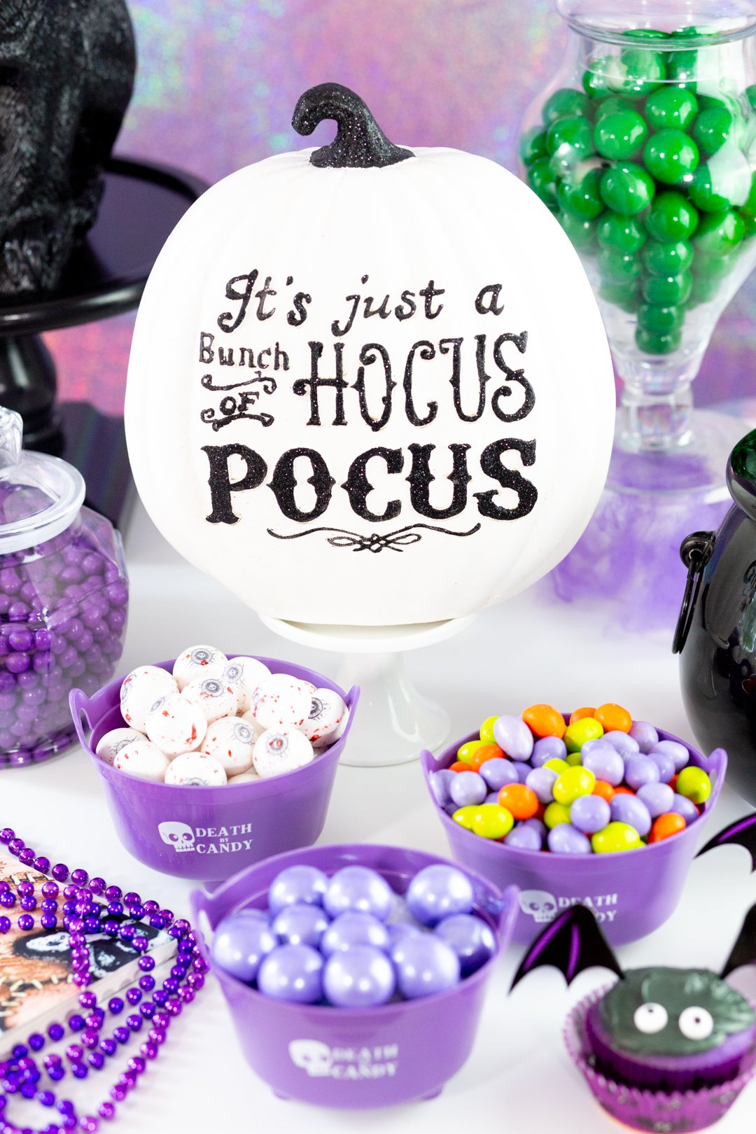 hocus pocus themed candy buffet with purple candies