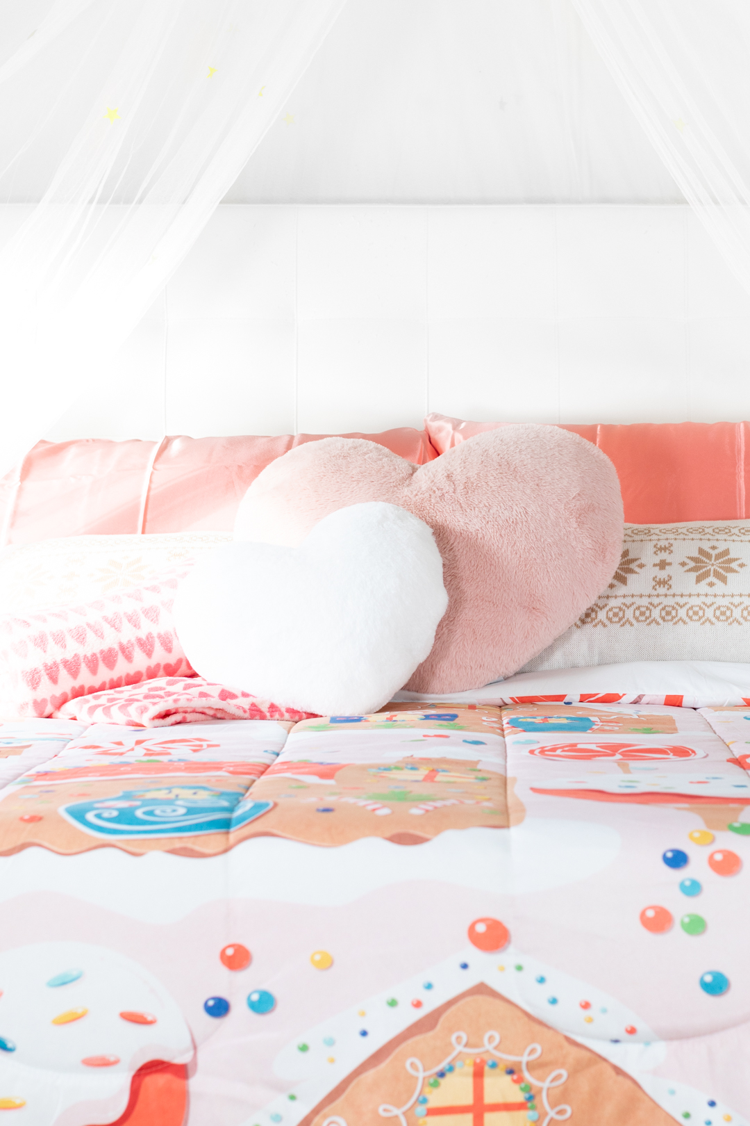 cute pillows on a holiday bed