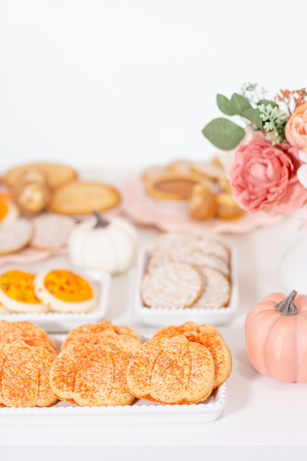 pumpkin-shaped cookies with orange sprinkles