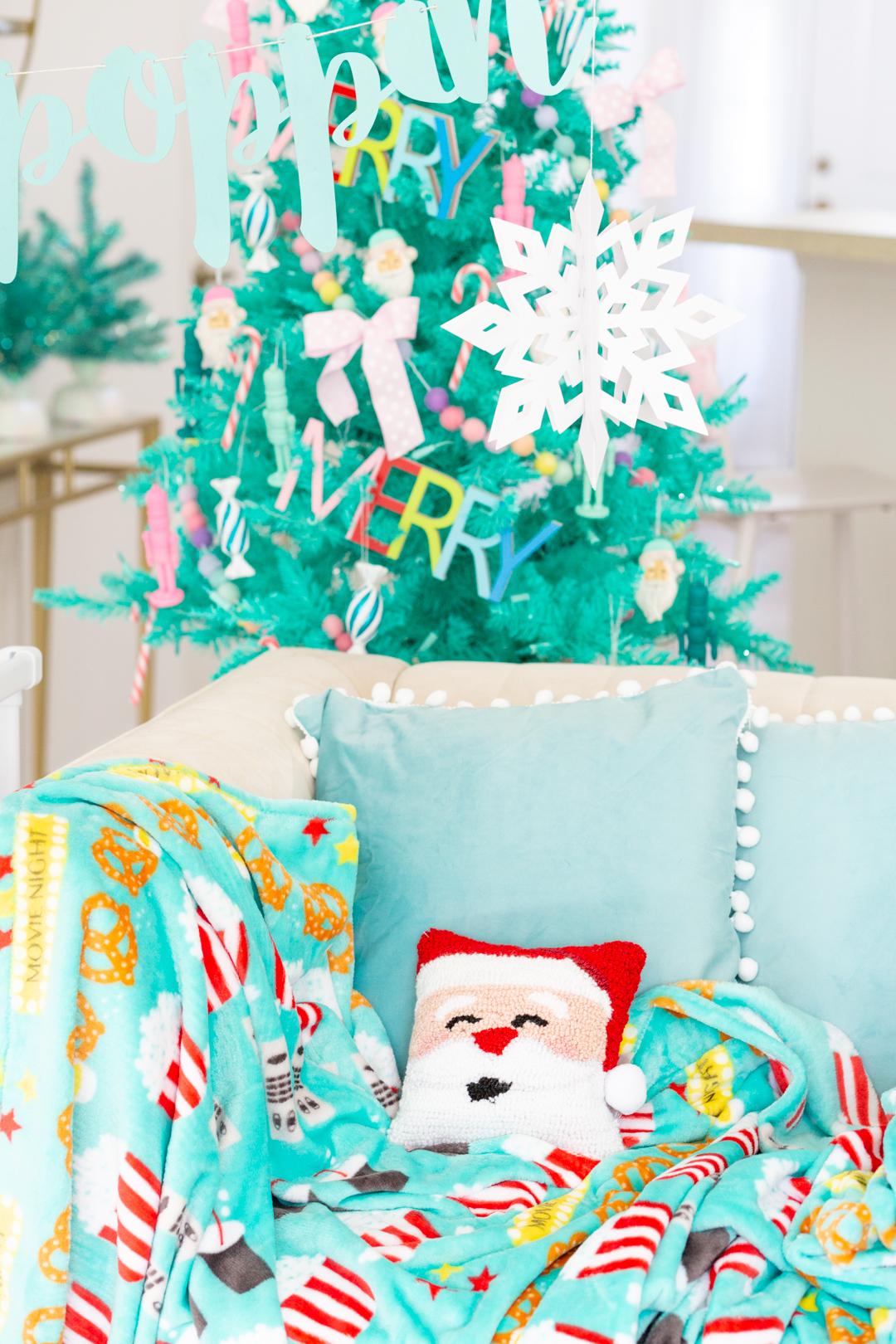 cozy movie night with movie themed throw and christmas tree