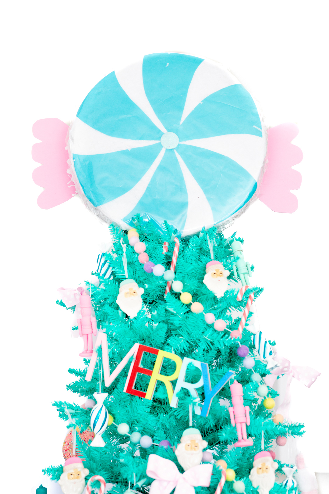 pretty teal christmas tree with peppermint pinata topper