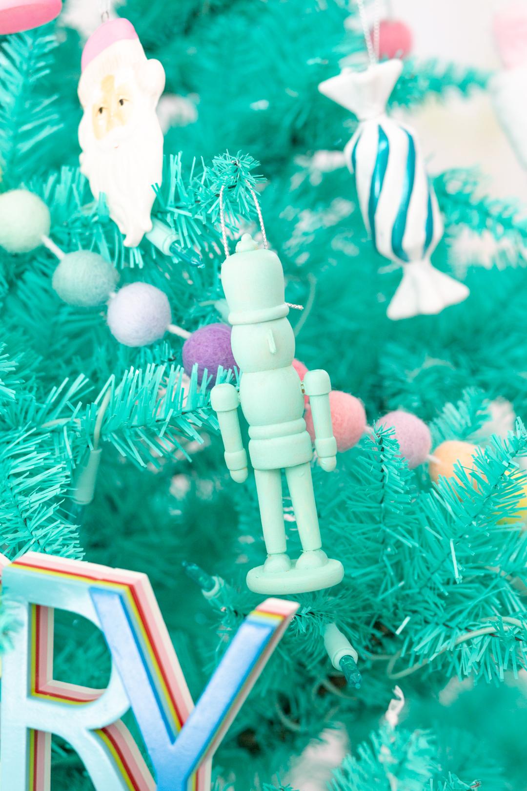 teal painted nutcracker ornament