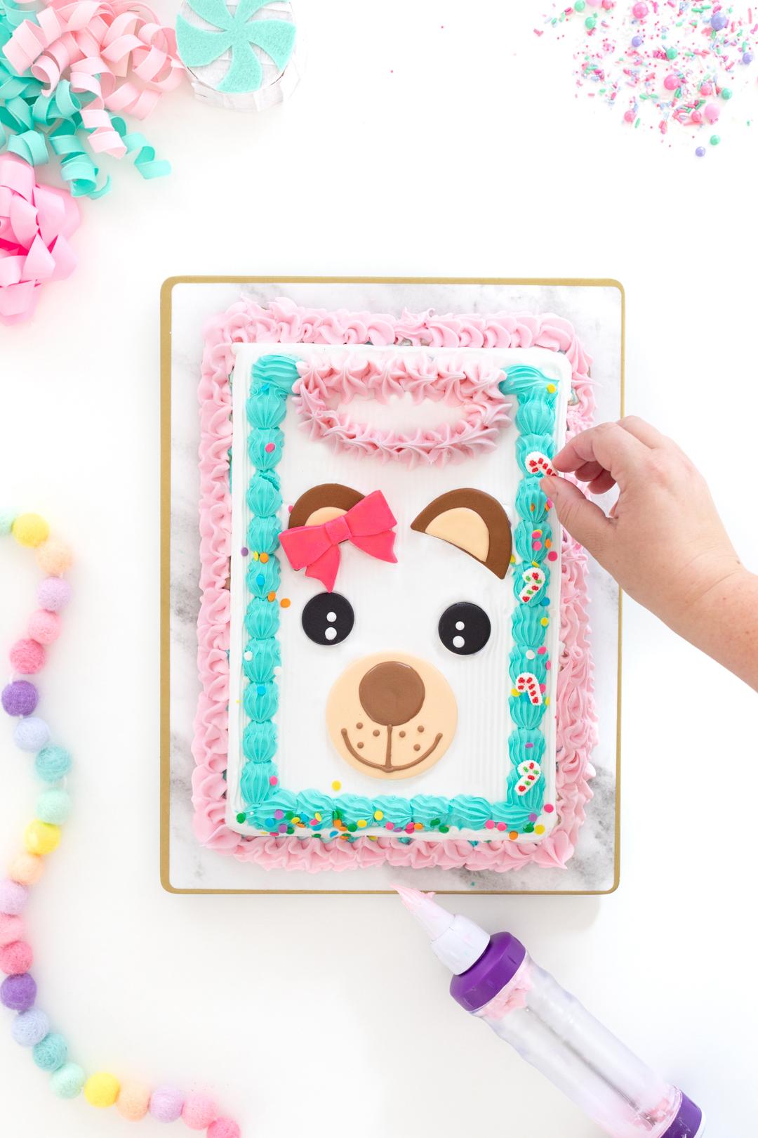 adding sprinkles to an ice cream cake