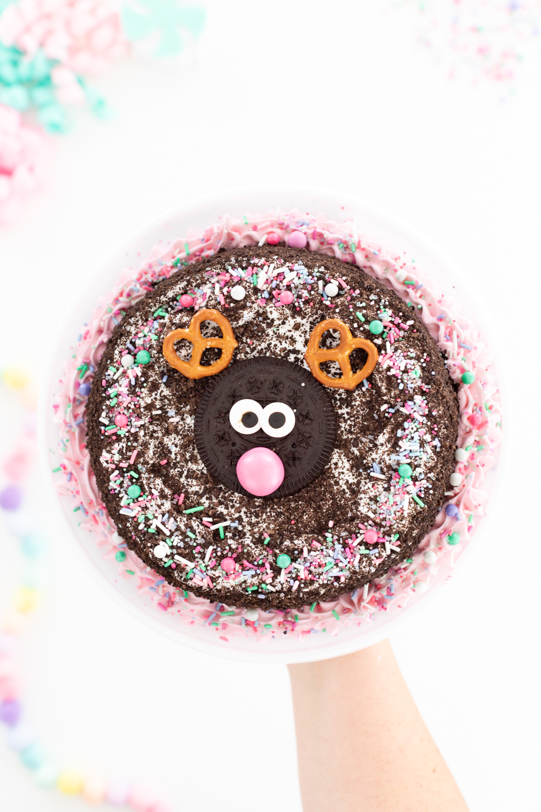 adorable ice cream cake with a reindeer in the center. pink gum ball nose