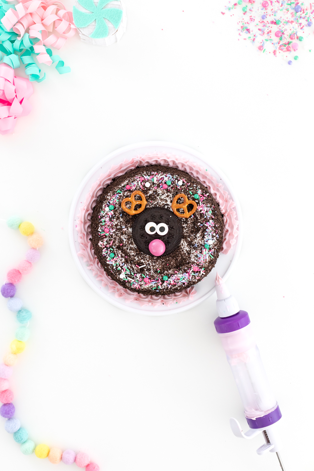reindeer ice cream cake with gum nose and pink frosting