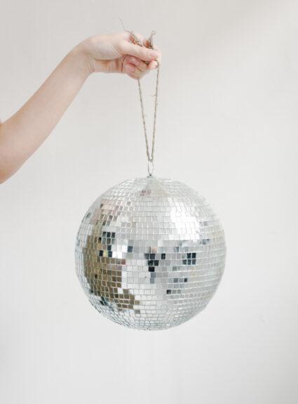 Girl holding a small disco ball