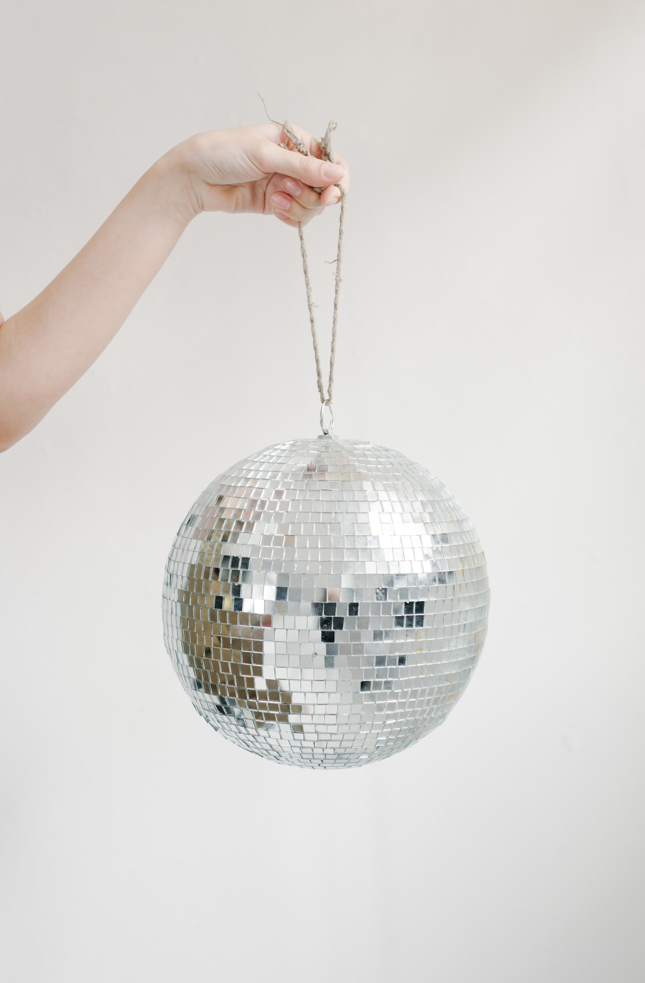 Girl holding a small disco ball