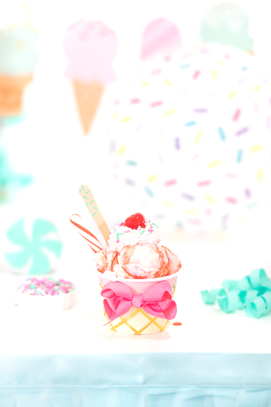pretty ice cream sundae with candy cane and pink strawberry syrup