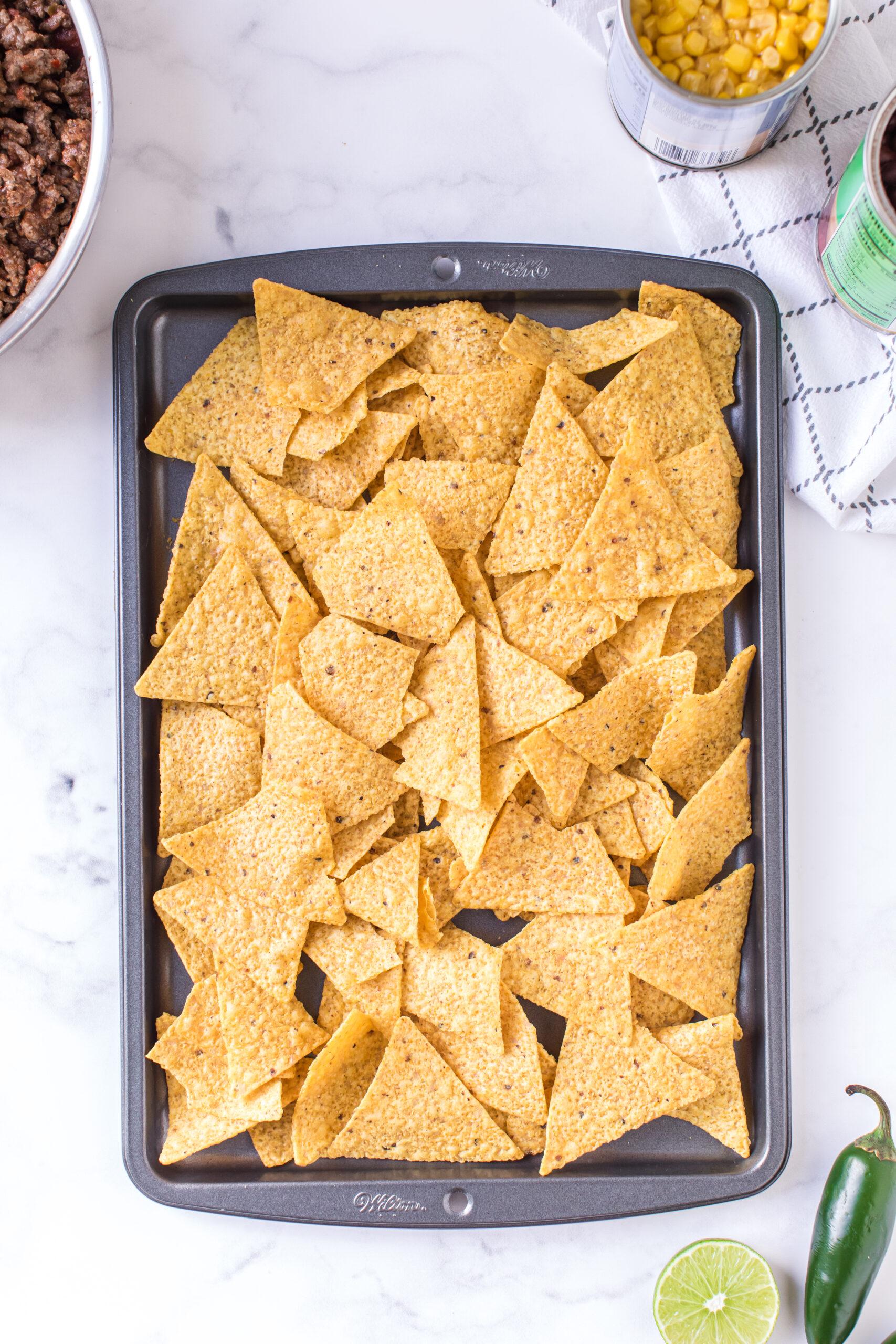 baking sheet with plain tortilla chips added