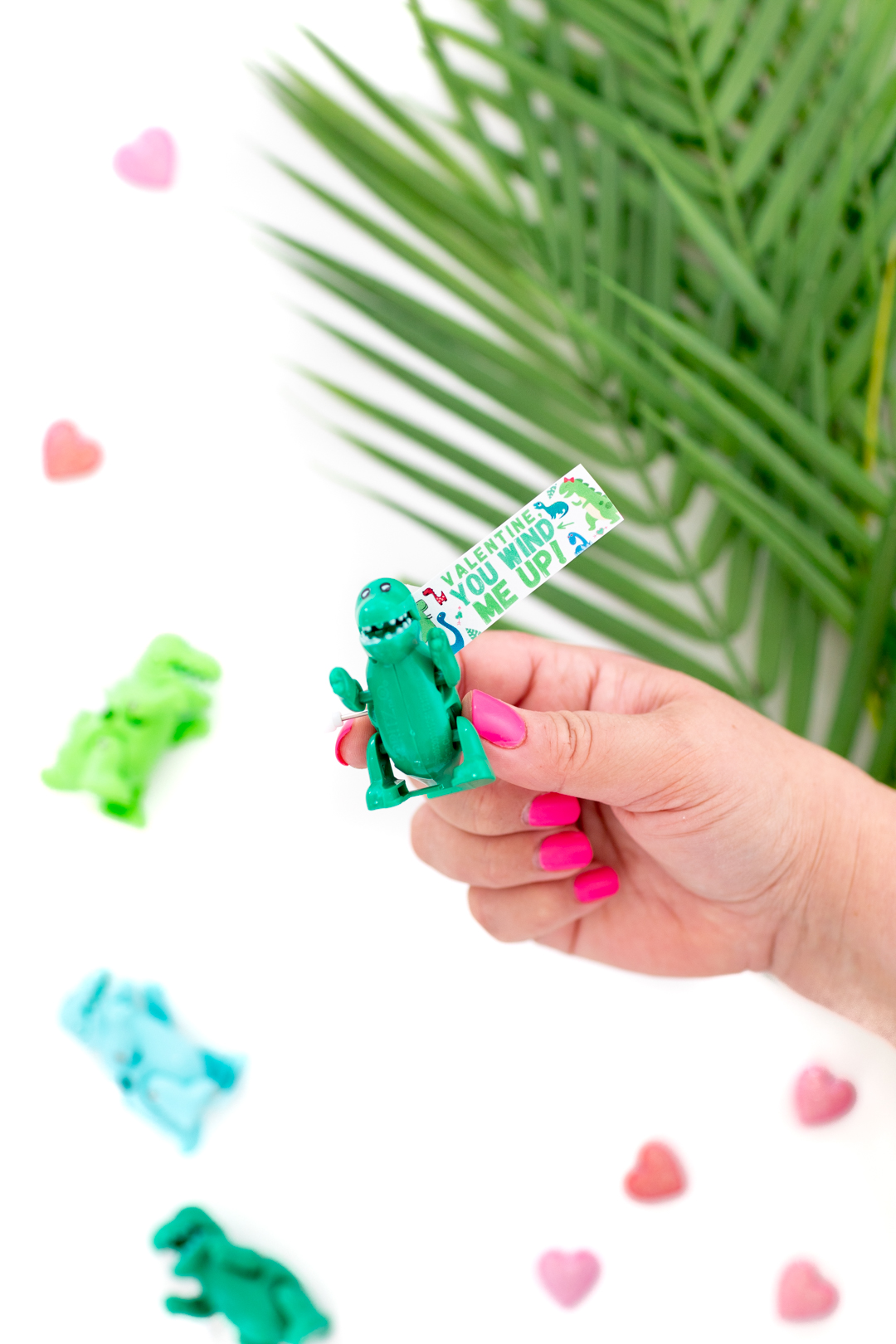 girl holding mini dino toy valentines day diy gift with printable gift tag